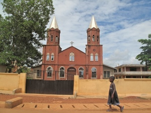 Child walking by a church